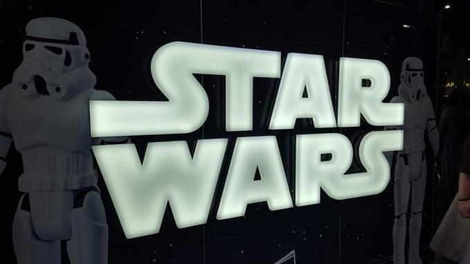 Stormtrooper Toys near an illuminated Star Wars sign